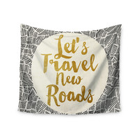 """Pom Graphic Design """"Let's Travel New Roads"""" Gold Black Wall Tapestry"""