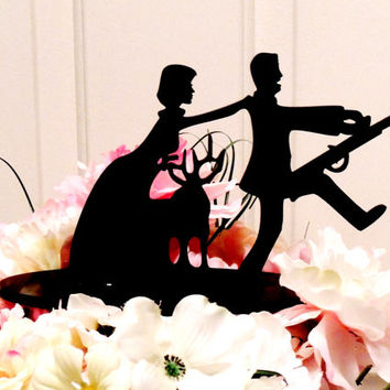Wife hunting her husband cake topper