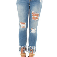 Medium Wash Distressed Denim with Shredded Hemline