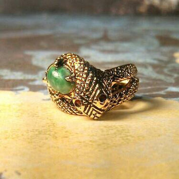Snake serpent with red rhinestone eyes, green stone, 18 k HGE new old stock. Size 6. Still has tag!