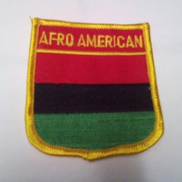 """AFRO AMERICAN AFRICAN FLAG PATCH EMBROIDERED SHIELD IRON ON SEW ON  2.5"""" x 2.75"""""""