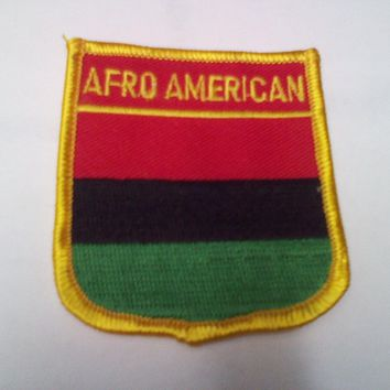 "AFRO AMERICAN AFRICAN FLAG PATCH EMBROIDERED SHIELD IRON ON SEW ON  2.5"" x 2.75"""