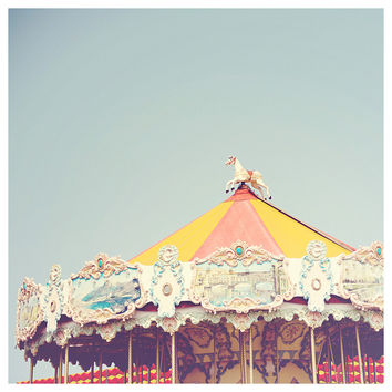carousel photograph, carousel, carnival, carnival photograph, merry go round, pastel, blue, red, yellow, color photography
