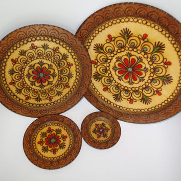 Vintage Handcarved Brown Wooden Plates Set of 4 Woodburning Pyrography Polish Decorative Round Ornament Plate Polish wooden wall hanging 60s