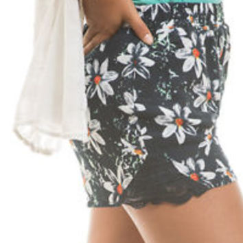 Blue and white daisy elastic waist shorts adorned with lace and fully lined