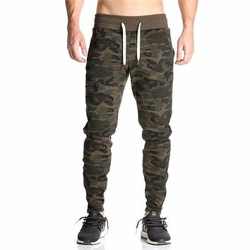 YUANHUIJIA Free shipping 2016 New Low rise Military thin men's camouflage harem personality Male plus size drawing pants M003