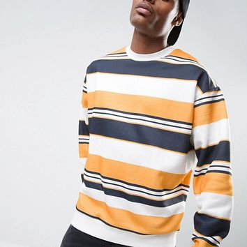 ASOS Oversized Sweatshirt With Stripe In Navy & Yellow at asos.com