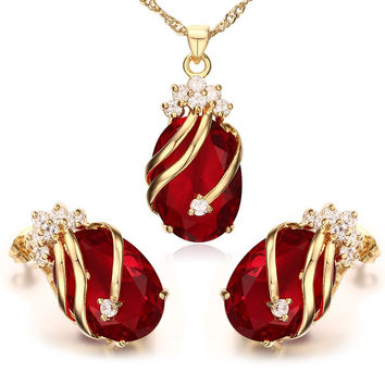 Red Rhinestone Swirl Pattern Pendant Necklace and Earrings