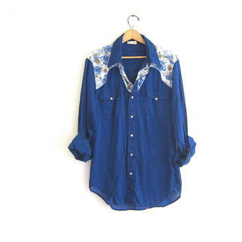 vintage western shirt. Navy blue with floral yoke top. white Pearl snaps.