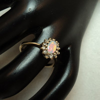 Beautiful .25 carat Fire Opal Ring with .18 total carat weight Diamonds set in 14KT Yellow Gold. Size 6. CR 166
