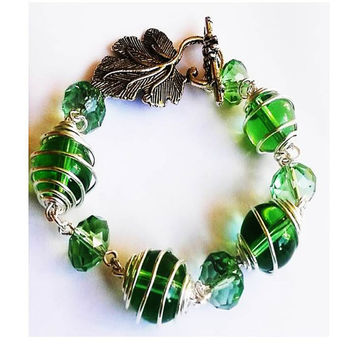 Green Glass Caged  Bead and Green Swarovski Crystal Bead Bracelet With Leaf Pendant Toggle