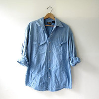 vintage 80s washed out denim jean shirt. pearl snap button down shirt. oversized pearl snap western shirt.