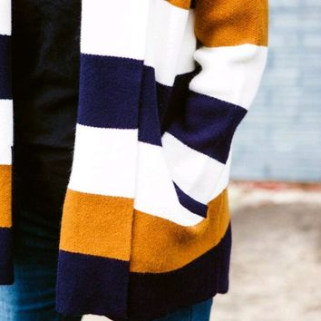 The preppy cowgirl sweater