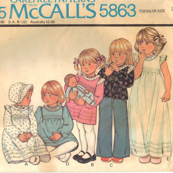 McCalls 5863 Sewing Supply Pattern Toddlers Dress Or Top And Hat - CUT