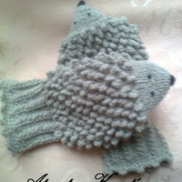 Hand knit hedgehog mittens gloves.