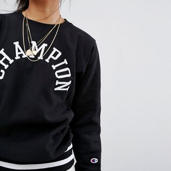 Champion Crew Neck Sweatshirt With Varsity Logo at asos.com