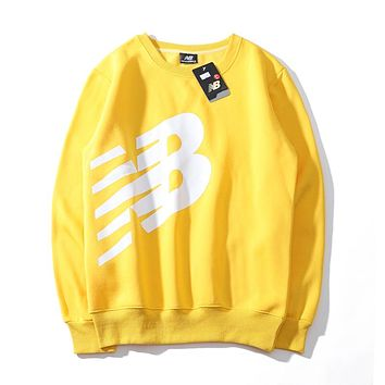 New Balance Fashion Women Men Loose Print Round Collar Velvet Sweater Pullover Top Yellow
