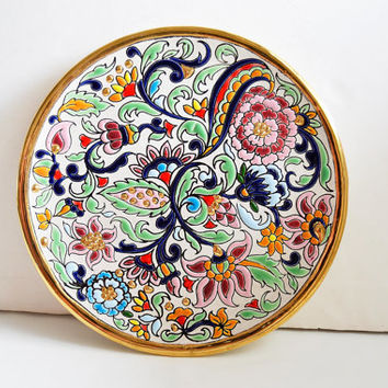 Profiled plate and enameled decoration handmade old Arab Renaissance formulas i .Enrececidos with 24 kt gold fire.