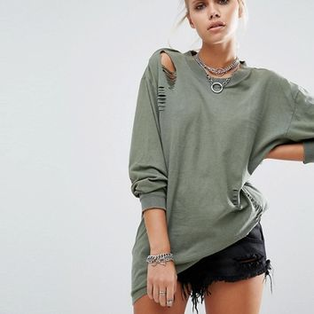 Milk It Vintage Oversized Distressed T-Shirt With Open Back In Long Sleeve at asos.com