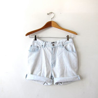 Vintage beached out white shorts. Cut off denim shorts. Frayed jean shorts. Worn in distressed denim shorts. High waist shorts