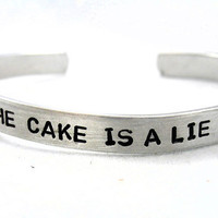 Hand Stamped Portal Bracelet   The Cake Is a Lie  by foxwise