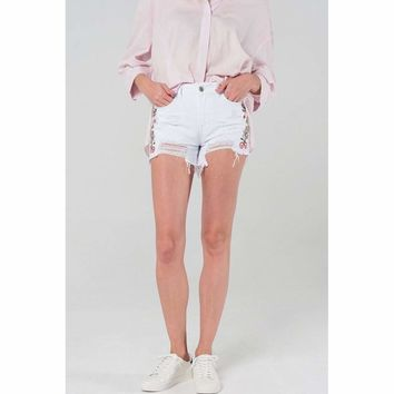 Distressed white denim shorts with embroidery