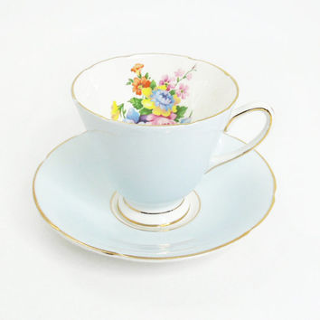 Old Royal Bone China tea cup saucer set - Baby blue gold trim with colorful flowers inside - Made in England