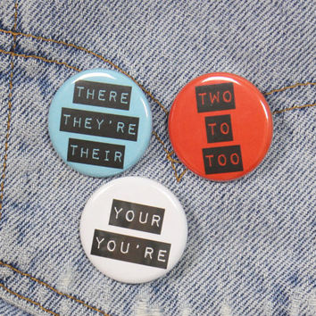 Grammar Police Set With . Your You're . Two To Too . There They're Their . Set Three Pack 1.25 Inch Pin Back Buttons Badges