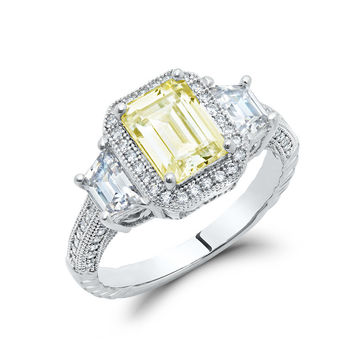 Sterling silver bonded with platinum emerald cut 3 stone lab grown canary pave ring and simulated diamonds by swarovski.  ZR-0232CA