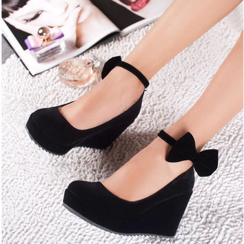 Suede Round Toe Bow Wedge Heels