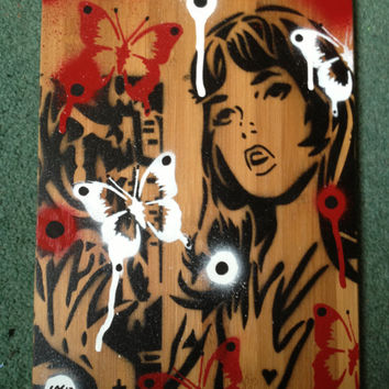 comic book woman painting on bamboo wooden tile,stencils & spraypaints,red,white,black,butterflies,wood effect,lichtenstien,europe,urban