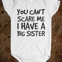Supermarket: You Can't Scare Me I Have A Big Sister Baby Onesuit from Glamfoxx Shirts